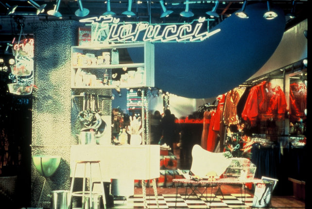 La fortuna internazionale di Fiorucci cominciò con il primo negozio aperto a Milano, in Galleria Passarella, nel 1967. Chiave del suo successo travolgente, oltre allo stile pop, coloratissimo e assolutamente innovativo per l'Italia di quegli anni, è anche nell'«invenzione» del «concept store»: nella storica bottega Fiorucci non si vendevano solo vestiti, ma anche scarpe, gadget, musica, perfino cibi e bevande. Tutti sgargianti.