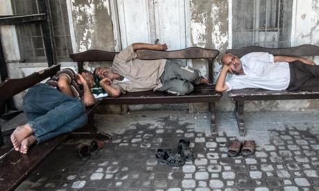 Exhausted Gazans outside the Greek Orthodox Church