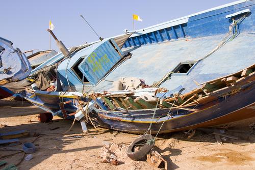 lampedusa-pescatori-profughi-shutterstock_152651534