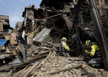 Members of the Chinese rescue team search in debris of collapsed houses after Saturday's earthquake in Bhaktapur, Nepal, Tuesday, April 28, 2015. Many people have camped outdoors in the chilly night cold since Saturdayís massive earthquake that shook Nepalís capital and the densely populated Kathmandu valley. (AP Photo/Bernat Armangue)