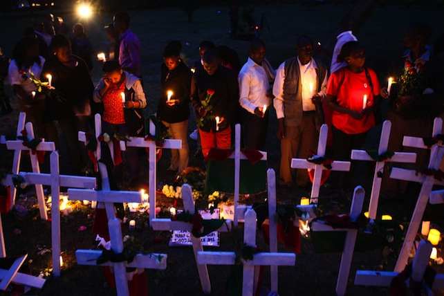Kenya red cross team gather for a candlelight vigil to mourn the 148 people killed in Garissa attack