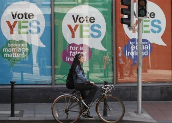 YES posters cover a shop's windows in the center of Dublin, Ireland, Thursday May 21, 2015.  People from across the Republic of Ireland will vote Friday in a referendum on the legalization of gay marriage, a vote that pits the power of the Catholic Church against the secular-minded Irish government of Enda Kenny.  (AP Photo/Peter Morrison)