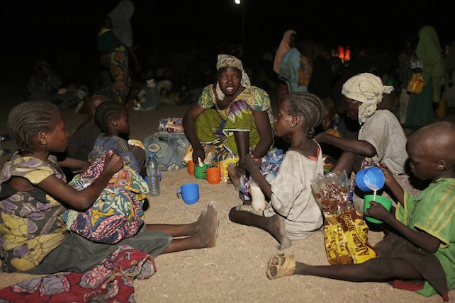 Women are children rescued by Nigeria soldiers from Islamist extremist  at Sambisa forest  eat a meal at a camp in  Yola Nigeria, Saturday May. 2, 2015. The first group of nearly 300 Nigerian girls and women released from Boko Haram were brought by the military to the safety of a refugee camp in the country's northeast Saturday evening. More than 677 females have been released this week, as the Nigerian military continues its campaign to push the Islamic extremists out their last remaining strongholds in the Sambisa Forest. ( AP Photo/Sunday Alamba)