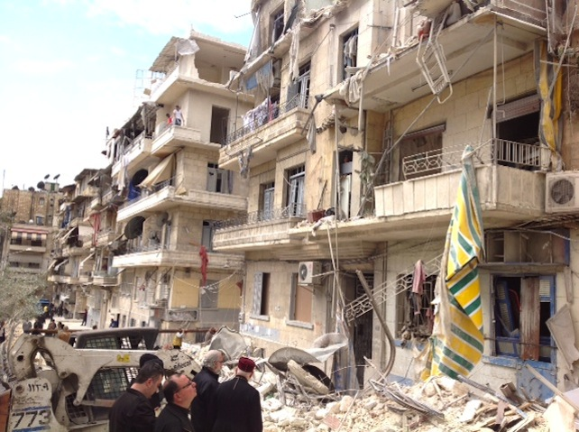Syria, Aleppo April 2015 Damage to Christian quarter of Aleppo after recent attacks: Archbishop Jean-Clement Jeanbart inspecting the damaged quater Only this small file quality available