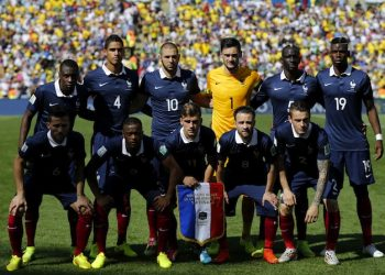 epa04298876 The team of France (front row, L-R) Yohan Cabaye, Patrice Evra, Antoine Griezmann, Mathieu Valbuena, Mathieu Debuchy and (back row, L-R) Blaise Matuidi, Raphael Varane, Karim Benzema, goalkeeper Hugo Lloris, Mamadou Sakho and Paul Pogba pose for a team picture before the FIFA World Cup 2014 quarter final match between France and Germany at the Estadio do Maracana in Rio de Janeiro, Brazil, 04 July 2014.   (RESTRICTIONS APPLY: Editorial Use Only, not used in association with any commercial entity - Images must not be used in any form of alert service or push service of any kind including via mobile alert services, downloads to mobile devices or MMS messaging - Images must appear as still images and must not emulate match action video footage - No alteration is made to, and no text or image is superimposed over, any published image which: (a) intentionally obscures or removes a sponsor identification image; or (b) adds or overlays the commercial identification of any third party which is not officially associated with the FIFA World Cup)  EPA/ABEDIN TAHERKENAREH   EDITORIAL USE ONLY