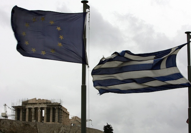 epa03094561 A Greek (R) and European flag (L) flutter in front of the Parthenon of the Acropolis in Athens, Greece, on 06 February 2012. Greek Prime Minister Lucas Papademos was to resume talks with his coalition partners on 06 February in an effort to reach agreement on a new multi-billion euro bailout deal with international lenders. Greece's two largest private and public sector unions called for a 24-hour, nationwide strike on 07 February against the tough austerity measures demanded by international lenders.  EPA/SIMELA PANTZARTZI