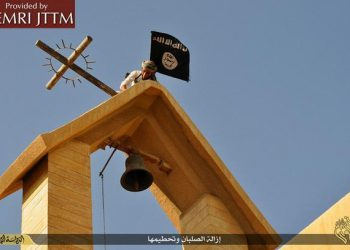 On March 16, 2015, the Islamic State (ISIS) published a collection of images showing an array of acts of vandalism perpetrated against churches in Ninawa, Iraq. The images show ISIS men engaged in the destruction of various Christian symbols, which ISIS perceives as being polytheistic and idolatrous. The men remove crosses from atop churches and replace them with the black ISIS banner, destroy crosses at other locations such as atop doorways and gravestones, and destroy and remove icons and statues inside and outside churches. Ansa/MEMRI's Jihad and Terrorism Threat Monitor (JTTM) ++ No sales, editorial use only ++