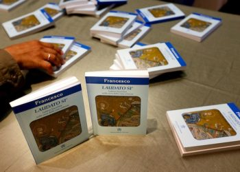 """Copies of Pope Francis's encyclical, a collection of principles to guide Catholic teaching, entitled """"Laudato Si """" lies on a table during its official presentation at the Sinod hall in the Vatican, 18 June 2015.   ANSA/ALESSANDRO DI MEO"""