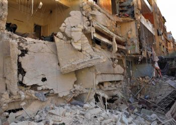 epa04801571 A handout picture made available by Syrian Arab news agency SANA shows a damaged building after a rocket attack at Bani Zeid neighborhood in Aleppo city Syria 15 June 2015. According to SANA the death toll from rocket attacks on Aleppo city has risen to 23 a source at Aleppo Health Directorate said. The source pointed out that the death toll is likely to rise due to the critical cases of many wounded, adding that al-Razi and the University hospitals received more than 100 casualties.  EPA/SANA / HANDOUT   EDITORIAL USE ONLY/NO SALES