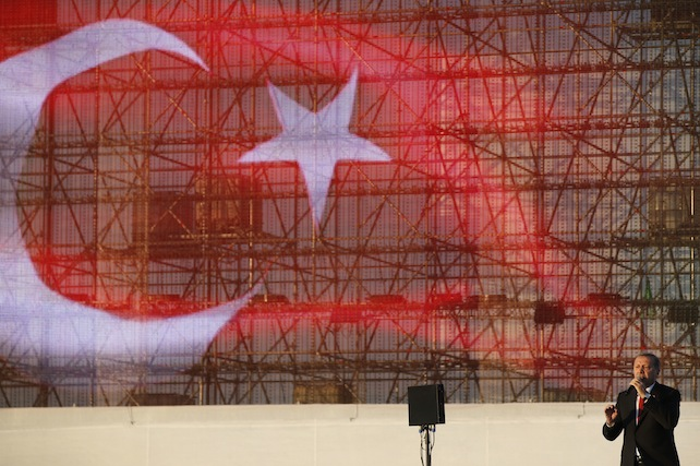 In this Saturday, May 30, 2015, photo, Turkey's President Recep Tayyip Erdogan delivers a speech in Istanbul, Turkey, during a rally to commemorate the anniversary of city's conquest by the Ottoman Turks. Turkey will hold general election on June 7.  (AP Photo/Lefteris Pitarakis)