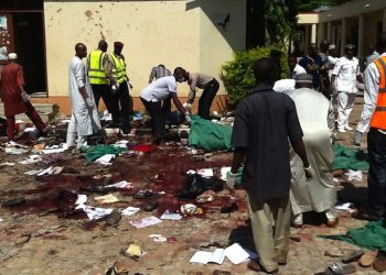 epa04835377 Members of the Jama'atu nasiril Islam first aid group, Red Cross helpers and security agents jointly search the scene for victims after a suicide bomber detonated a bomb at a local government building in the Sabon Gari district of the city of Zaria, Kaduna State, northern Nigeria, 07 July 2015. The suicide bomber reportedly entered a local government building as hundreds of civil servants were undergoing an identity check and detonated a bomb, killing at least 20 people. The blast was the latest in a string of attacks that have claimed more than 200 lives in Africa's largest economy in the past week alone. No group has yet claimed responsibility for the attack, but suspicion has been cast on Boko Haram, an extremist group which has killed more than 14,000 people since 2009 as it seeks to establish an Islamic state in northern Nigeria.  EPA/STRINGER ATTENTION EDITORS: PICTURE CONTAINS GRAPHIC CONTENT * BEST QUALITY AVAILABLE