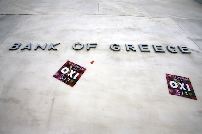 Stickers are seen under the Bank of Greece logo with the word ''NO'' referring to the upcoming referendum in Athens, Thursday, July 2, 2015. The battle for Greek votes entered full swing Thursday ahead of a crucial weekend referendum that could decide whether the country falls out of the euro. (AP Photo/Thanassis Stavrakis)