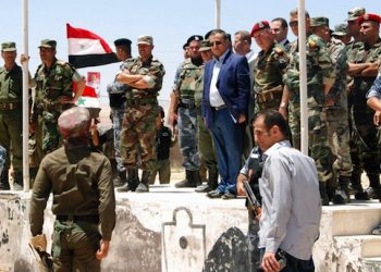 epa03800191 A handout picture made available by Syrian Arab news agency SANA shows Syrian Interior Minister Maj. Gen. Mohammed Chaar (RC) speaks as he attends military maneuvering carried out by members of the forces of order and security in unknown area in Syria 24 July 2013.  EPA/SANA HANDOUT   EDITORIAL USE ONLY/NO SALES