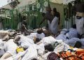 Muslim pilgrims gather around bodies of people crushed in Mina, Saudi Arabia during the annual hajj pilgrimage on Thursday, Sept. 24, 2015. Hundreds were killed and injured, Saudi authorities said. The crush happened in Mina, a large valley about five kilometers (three miles) from the holy city of Mecca that has been the site of hajj stampedes in years past. (AP Photo)
