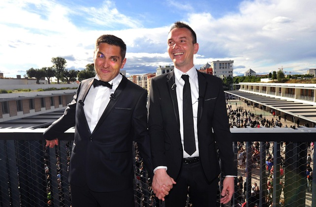 epa03722978 Vincent Autin (R) and his partner Bruno Boileau (L) pose for photographers during their marriage in Montpellier, southern France, 29 May 2013. France's first gay marriage was sealed 29 May in the southern city of Montpellier, where Vincent Autin and Bruno Boileau became the first same-sex couple to say 'I do.' Autin, 40, and Boileau, 30, were married by Montpellier's Socialist mayor, three days after the last of massive, increasingly violent protests over a gay marriage and adoption bill that became law 28 May.  EPA/GERARD JULIEN/POOL