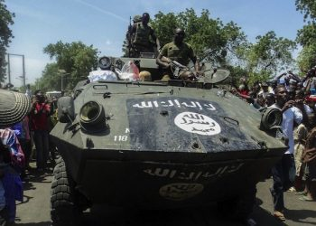 epa04403951 Nigerian soldiers display one of the captured Boko Haram armoured vehicles as they drive it through Maiduguri, Nigeria, 17 September 2014. The Nigerian military is currently engaged in opperations against Boko Haram insurgents and says it has killed more than one hundered Boko Haram militants in their defence of Konduga in north eastern Borno state. Boko Haram has waged a terror war in Nigeria for over five years and has been trying to establish a caliphate in Borno since 2009.  EPA/Tony Nwosu