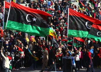 epa04624392 Libyans wave national flags as they celebrate the fourth anniversary of the uprising at Martyrs square, in Tripoli, Libya, 17 February 2015. Libyans are marking the anniversary of the 17 February 2011 revolution, that ended the rule of Muammar Gaddafi, amid division and violence after an Islamist-led militia seized the capital Tripoli in recent months, forcing the elected parliament and its government to relocate to the far eastern city of Tobruk.  EPA/STR