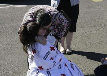 epa04959721 Umpqua Community College freshman, Hannah Miles receives a hug from her mother at the Douglas County Fairgrounds, after a 26-year-old gunman opened fire at the Umpqua Community College in Roseburg, Oregon, USA, 01 October 2015. Law enforcement officials say 26-year-old Chris Harper Mercer opened fire on a community college campus in the north-western US state of Oregon, killing a reported ten people and injuring seven before law enforcement shot him dead. Douglas County Sheriff John Hanlin said the gunman at Umpqua Community College in Roseburg, Oregon, was dead, and that authorities believed he had acted alone.  EPA/Gary Breedlove