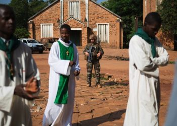 epa04333244 A French soldier of the military Operation Sangaris stands guard at the St. Joseph Cathedral, the site of an attack by Seleka rebel fighters earlier in the month, during Sunday Mass in Bambari, Central African Republic, 27 July 2014. The attack on the church, where thousands of Christians had taken refuge, left an estimated 17 people dead and many others injured. Violence between the anti-Balaka and Seleka rebel groups continues despite the ceasefire agreement signed in Congo Brazzaville on 24 July. Thousands have been killed in the conflict since 2013 with nearly a million being forced from their homes.  Bambari, controlled by the Muslim-majority Seleka, has seen some of the heaviest fighting in the country in the past month and is now considered a fault line dividing the Christian-dominated south from the mostly Muslim-dominated north.  EPA/TANYA BINDRA