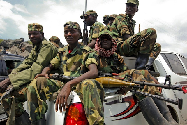 epa03936382 (FILES) A group of M23 rebel fighters sit on a pickup truck as they prepare to leave the city, in Goma, eastern Democratic Republic of Congo, 01 December 2012. The M23 rebel group in the eastern Democratic Republic of Congo is ending its insurgency, it was announced 05 November 2013. In a statement the movement said it would adopt 'purely political means' to achieve its goals and urged its fighters to disarm and demobilise.  EPA/DAI KUROKAWA