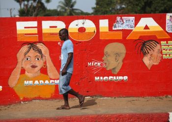 epa04739380 (FILE) A file picture dated 22 March 2015 shows a Liberian man walking pass an ebola awareness painting on a wall in downtown Monrovia, Liberia. Liberia is declared free from Ebola on 09 April 2015 after 42 days without a new case, the medical charity Medecins Sans Frontieres reported, but urged vigilance until the worst-ever recorded outbreak of the virus is extinguished in neighbouring Guinea and Sierra Leone. The last patient in Liberia died on 27 March 2015, and by 09 April 2015 the nation reaches the official World Health Organization (WHO) standard of 42 days without a new Ebola case. A total of 10,980 people have been killed and more than 26,500 people were infected by Ebola disease since the outbreak erupted in a remote area of Guinea in December 2013, according to WHO.  EPA/AHMED JALLANZO