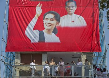 Leader of Myanmar's National League for Democracy party, Aung San Suu Kyi delivers a speech from a balcony of the NLD headquarters in Yangon, Myanmar, Monday, Nov. 9, 2015. With tremendous excitement and hope, millions of citizens voted Sunday, Nov. 8 in Myanmar's historic general election that will test whether the military's long-standing grip on power can be loosened, with opposition leader Aung San Suu Kyi's party expected to secure an easy victory.(AP Photo/Mark Baker)