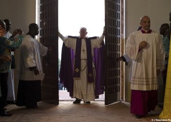In this picture taken Sunday, Nov. 29, 2015, Pope Francis opens the holy door of the Bangui cathedral, Central African Republic. Pope Francis is in Africa for a six-day visit that is taking him to Kenya, Uganda and the Central African Republic.  (L'Osservatore Romano/Pool Photo via AP)