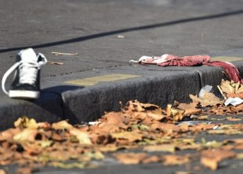 epa05026346 A shoe and a blood-stained cloth lie on the ground near the Bataclan concert venue in Paris, France, 15 November 2015. More than 120 people have been killed in a series of attacks in Paris on 13 November, according to French officials. Eight assailants were killed, seven when they detonated their explosive belts, and one when he was shot by officers, police said. French President Francois Hollande says that the attacks in Paris were an 'act of war' carried out by the Islamic State extremist group.  EPA/UWE ANSPACH