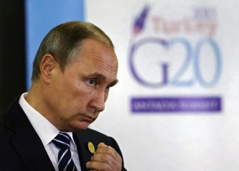 epa05028361 Russian President Vladimir Putin speaks during his press conference after G20 summit in Antalya, Turkey, 16 November 2015. In addition to discussions on the global economy, the G20 grouping of leading nations is set to focus on Syria during its summit this weekend, including the refugee crisis and the threat of terrorism.  EPA/YURI KOCHETKOV