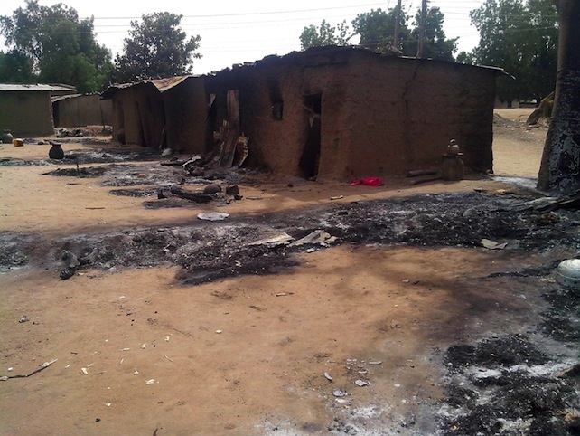 epa04100296 (FILE) A file photograph dated 28 January 2013 showing the remains of houses after a Boko Haram attack, killing 70 people, in Kawuri, Nigeria. Reports on 25 February 2014 state that suspected Islamist militants attacked a school 25 February 2014 and killed 43 people in north-eastern Nigeria, local officials and hospital sources said. More than 50 gunmen thought to belong to the Boko Haram group stormed the school in Buni Yadi in Yobe state in the early morning, a member of the school committee said. The attackers kicked open the doors of buildings where students were sleeping. They slit the throats of many of them, avoiding the use of firearms in order not to attract the attention of security personnel manning a checkpoint nearby.  EPA/STRINGER