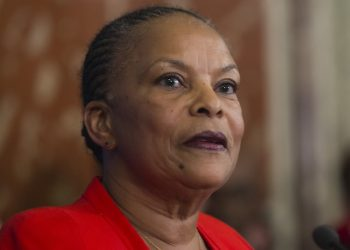 French outgoing Justice Minister Christiane Taubira speaks as she leaves the French Justice Ministry in Paris Wednesday Jan. 27,2016. following the handover ceremony. Franceís charismatic justice minister has resigned after objecting to the presidentís push to revoke citizenship of convicted terrorists with dual nationality. President Francois Hollande announced Christiane Taubiraís resignation  She is a devoted leftist best known for championing the legalization of gay marriage. Taubira is being replaced by Jean-Jacques Urvoas, a Socialist lawmaker from Brittany considered a specialist on security issues who is seen as close to Prime Minister Manuel Valls. (AP Photo/Jacques Brinon)