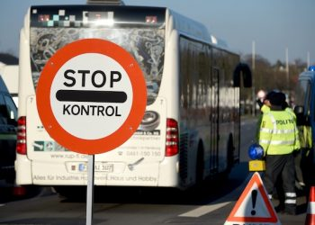 Members of the Danish police have set up a border checkpoint at Krusa border crossing near Flensburg, Germany,  Tuesday Jan. 5, 2016. Denmark introduced temporary controls along its border with Germany.   (Carsten Rehder/dpa via AP)