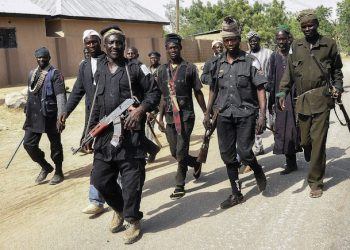 epa04628282 A picture made available on 20 February 2015, shows a group of Nigerian vigilantes, which comprises traditional hunters, as they patrol in North East Nigeria to assist the Nigerian military in fighting against Boko Haram Islamic militants, Nigeria, 17 February 2015. According to a military spokesperson at least 300 Boko Haram militants have been killed in recent operations by the Nigerian military in Nigeria's north east. Nigeria, Niger, Cameroon, and Chad are working in a military coalition which seems to be making gains against the terror group.  EPA/STR BEST QUALITY AVAILABLE