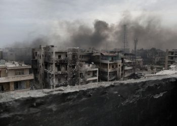 FILE - In this Tuesday, Oct. 2, 2012 file photo, smoke rises over Saif Al Dawla district, in Aleppo, Syria. Aleppo was one of the last cities in Syria to join the uprising against President Bashar Assadís government which began in 2011. (AP Photo/Manu Brabo, File)
