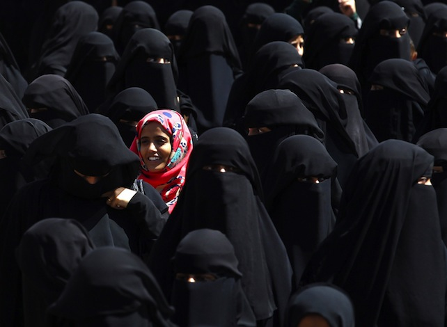 epaselect epa04963330 A Yemeni girl stands among burqa clad women during a rally protesting against Saudi-led coalition airstrikes outside the UN offices in Sanaa, Yemen, 04 October 2015. According to reports, the United Nations Children's Fund (UNICEF) has underscored the devastating toll six months of violence and Saudi-led coalition airstrikes has taken on the children of Yemen, where at least 500 have lost their lives.  EPA/YAHYA ARHAB