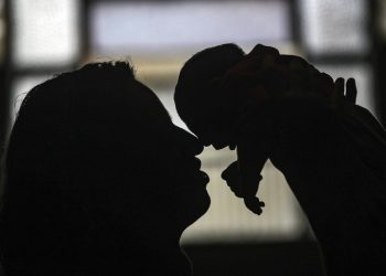 epa05156300 A picture made available on 12 February 2016 of Patricia Vieira de Araujo (L) holding her one-month-old granddaughter Manuelly Araujo da Cruz, who was born with microcephaly after being exposed to the zika virus during her mother's pregrnacy, in Rio de Janeiro, Brazil, 11 February 2016. The mother Leticia de Araujo, who caught the Zika virus during her third month of pregnancy, says that it is possible to raise her daughter in a completely normal way. 'The only difference is that Manuelly has a time when she cries a lot and gets very nervous waving her arms' but 'beyond that is normal'.  EPA/ANTONIO LACERDA
