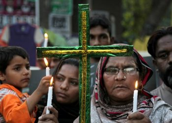Pakistani Christians hold candles during vigil for the victims of Sunday's suicide bombing, at close to bombing's site in Lahore, Pakistan, Tuesday, March 29, 2016. The government had vowed to crack down on extremism after a suicide bomber targeted Christians celebrating Easter in Lahore, killing more than 70 people. The attack was claimed by a breakaway Taliban faction that supports the Islamic State group. (AP Photo/K.M. Chaudary)