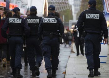 epa05033098 French police officers patrol the outdoor Christmas market on the renowned Avenue des Champs-Elysees in Paris, as part of the state-of-emergency and heightened security measures in Paris following the 13 November attacks, in Paris, France, 19 November 2015. Paris suffered terrorist attacks at the hands of the so-called Islamic State on November 13, when Islamist suicide bombers and gunmen claimed the lives of 129 people, and injured 352.  EPA/IAN LANGSDON
