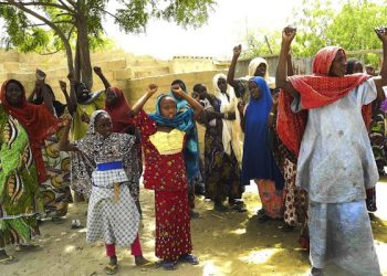 epa04678489 A photograph made available on 25 March 2015 shows Michika residents cheering the Nigerian military after their flushing out of Boko Haram Islamic militants from their town in Michika, North East Nigeria, 19 March 2015. The Nigerian military have been working in conjunction with neighbouring West Arican countries to contain the wave of attacks by Boko Haram Islamic militants in the North East of Africa's most populous country where Boko Haram have been conducting acts of terror for the past five years.  EPA/STR