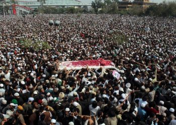 Thousands of people move with an ambulance carrying the body of police officer Mumtaz Qadri, the convicted killer of a former governor, during funeral prayers, in Rawalpindi, Pakistan, Tuesday, March 1, 2016. Tens of thousands of Pakistanis converged Tuesday on a city near the country's capital to attend the funeral of Qadri who was executed Monday for assassinating the secular governor in 2011 over accusations of blasphemy. (AP Photo/Anjum Naveed)