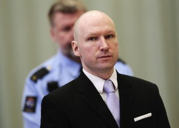 Anders Behring Breivik stands on the fourth and last day in court in Skien, Norway on Friday, March 18, 2016. Breivik, the right-wing extremist who killed 77 people in bomb and gun attacks in 2011 has arrived in court for his human rights case against the Norwegian government. (Lise Aserud, NTB scanpix via AP)  NORWAY OUT
