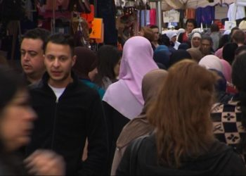 This is an image taken from video on Wednesday April 13, 2016 of  of Salah Abdeslam, 2nd left,  the fugitive from the Nov. 13 Paris attacks whose capture appears to have precipitated the March 22 bombing in Brussels. In the August 2014 Tvbrussel footage revealed Wednesday, Abdeslam is seen strolling casually through the Molenbeek market. Abdeslam, like many of the men in the Islamic State cell blamed for the pair of deadly attacks, is a native of the Brussels neighborhood. (Tvbrussels via AP) BELGIUM OUT