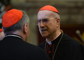 Cardinal Tarcisio Bertone during the traditional Greetings of Pope Francis to the Roman Curia on December 21, 2015 at the Vatican. ANSA / POOL - AFP PHOTO / ALBERTO PIZZOLI