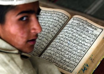Sabeel Ullah, a religious student at Al Jamia tul Islamia al-Naziria religious school is reading his daily exercise from Islam's holy book Quran in Islamabad, Pakistan on Thursday, 22 May 2003. The government of President Pervez Musharraf is under fire for not clamping down hard enough on the madrassas. In a major injection of new aid, the United States is donating Euro100 million over five years to Pakistan's troubled education system, including its religious schools or madrassas, even though they stand accused of being breeding grounds for Islamic extremism.   EPA-PHOTO/STR/SHABBIR HUSSAIN IMAM