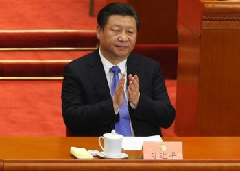 epa05210514 Chinese President Xi Jinping claps during the closing of the Fourth Session of the 12th National Committee of the Chinese People's Political Consultative Conference (CPPCC) at the Great Hall of the People (GHOP) in Beijing, China, 14 March 2016. The CPPCC is the top advisory body of the Chinese political system and runs alongside the annual plenary meetings of the 12th National People's Congress (NPC), together known as 'Lianghui' or 'Two Meetings'.  EPA/WU HONG
