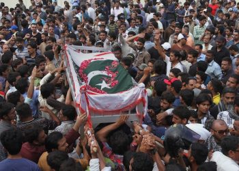 Mourners carry the coffin of slain activist Khurram Zaki during his funeral in Karachi, Pakistan, Sunday, May 8, 2016. A Pakistani police officer says gunmen riding motorcycles have shot and killed Zaki, a rights activist and wounded two other people in southern port city of Karachi. (AP Photo/Fareed Khan)