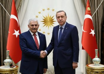 Turkey's President Recep Tayyip Erdogan, right, and Binali Yildirim, the ruling party's new chairman, pose for a photograph at the presidential palace in Ankara, Turkey, Sunday, May 22, 2016. Turkey's prime minister formally submitted his resignation on Sunday, paving the way for his replacement by a trusted ally of President Recep Tayyip Erdogan who immediately expressed allegiance to the Turkish leader and vowed to follow his path. (Presidential Press Service, Pool via AP Photo)