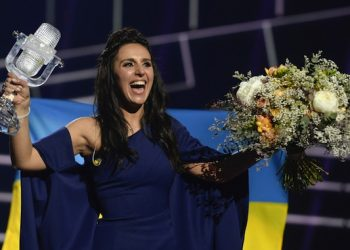 epaselect epa05306868 Ukraine's Jamala reacts after winning the 61st annual Eurovision Song Contest (ESC) at the Ericsson Globe Arena in Stockholm, Sweden, 14 May 2016. There were 26 finalists competing in the grand final.  EPA/MAJA SUSLIN SWEDEN OUT