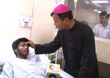 Pakistan, 2016 Archbishop Sebastian Shaw during his visit to Sheikh Zaid Hospital and Jinnah Hospital. He and his team visited both Christian and Muslim victims of the bomb blast in Pakistan over Easter . More than 300 people were injured and 72 people were killed by during the attack on Easter Sunday in Lahore. Here Archbishop Shaw is blessing one of the victims.