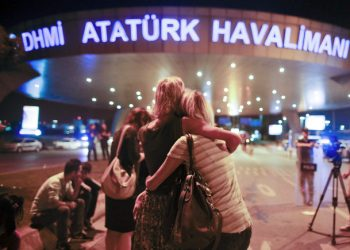 Passengers embrace each other on the entrance to Istanbul's Ataturk airport, early Wednesday, June 29, 2016 following its evacuation after a blast. Two explosions have rocked Istanbul's Ataturk airport Tuesday, killing several people and wounding scores of others, Turkey's justice minister and another official said. A Turkish official says two attackers have blown themselves up at the airport after police fire at them. Turkish authorities have banned distribution of images relating to the Ataturk airport attack within Turkey. (AP Photo/Emrah Gurel) TURKEY OUT